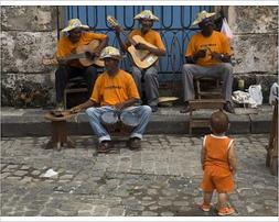 10x8 Print of Street band wearing orange shirts playing musi